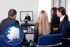 alaska businesspeople participating in a video conference