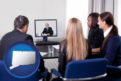 connecticut businesspeople participating in a video conference