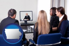 iowa businesspeople participating in a video conference