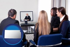 kansas businesspeople participating in a video conference