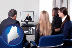 maine businesspeople participating in a video conference