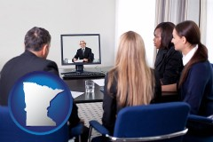 minnesota businesspeople participating in a video conference