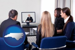 north-carolina businesspeople participating in a video conference