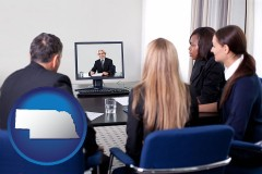 nebraska businesspeople participating in a video conference