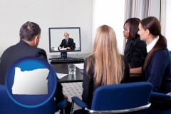 oregon businesspeople participating in a video conference