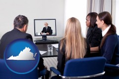 virginia businesspeople participating in a video conference