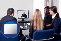 wyoming businesspeople participating in a video conference