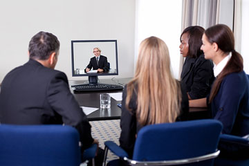 businesspeople participating in a video conference